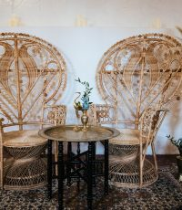 Peacock wicker seating area with round table